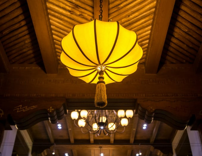 large yellow light fixture in hotel lobby